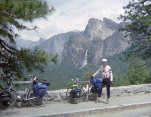 Cyclist & bike in Yosemite with Half Dome in background